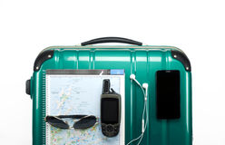Green travel suitcase. With items on white background Stock Photo