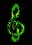 Green treble clef. On a black background Royalty Free Stock Photo