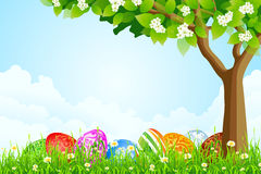 Green Tree Background with Easter Eggs Stock Images