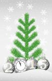 Green tree, clock and marbles with numbers 2015 on to snow Royalty Free Stock Photography