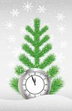 Green tree and clock on to snow Royalty Free Stock Photo
