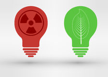 Green tree growing in a bulb, go green concept. Green tree leaf growing in a bulb, go green concept vs nuclear energy bulb Stock Photo