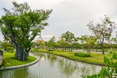Green tree and lake in park Bangkok Stock Photo