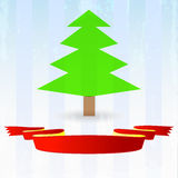 Green tree with red ribbon down Royalty Free Stock Image