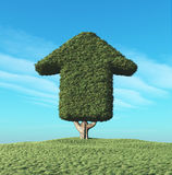 A green tree in the shape of an arrow Stock Photography