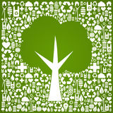 Green tree shape over eco icons background. Green tree symbol over eco icons background. Vector file available Royalty Free Stock Photo