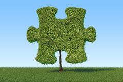 Green tree in the shape of puzzle on the green grass against blu stock illustration