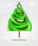 Green tree shape swirl with snowfall Royalty Free Stock Photography