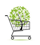 Green tree in shopping cart for your design Stock Photos