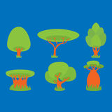 Green trees on a blue Stock Images