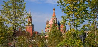 Green trees and grass on the background of the Moscow Kremlin and the red square in the park Zaryadye stock photography