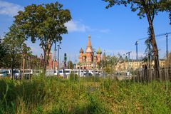 Green trees and grass on the background of the Moscow Kremlin and the red square in the park Zaryadye royalty free stock photography