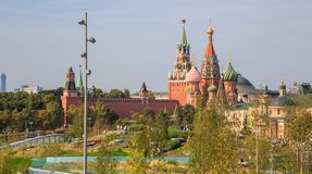 Green trees and grass on the background of the Moscow Kremlin and the red square in the park Zaryadye stock photos