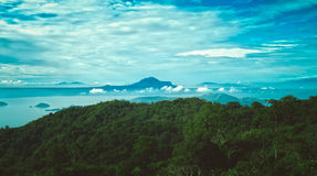 Green Trees on Hills With Body of Water View Under Clouds Royalty Free Stock Photos