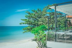 Green trees on sand beach with beautiful seascape view and blue sky in the background at Chao Lao Beach, Chanthaburi Province. Green trees on sand beach with Royalty Free Stock Image