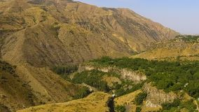 Green trees on slopes of Armenian hills, beautiful nature geology, aerial view. Stock footage stock footage