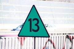 Green triangle sign along railroad indicating the speed 13 means 130 kilometers hour for the train in the Netherlands,. Green triangle sign along railroad stock photo