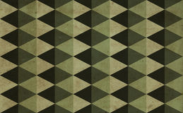 Green triangles background. Vintage style green military pattern background made with triangles overlaid with grungy elements Stock Images