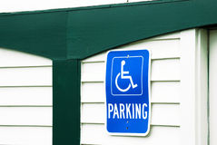 Green Trim by Handicapped Parking Sign Stock Photos
