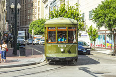 Green trolley streetcar on rail Royalty Free Stock Images