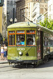 Green trolley streetcar on rail Stock Images