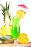 Green tropical cocktail with pineapple, orange and Stock Photos