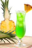 Green tropical cocktail with pineapple slice Royalty Free Stock Photography