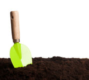 Green trowel in ground Royalty Free Stock Images