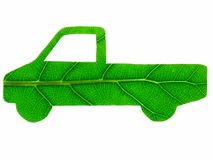Green Truck. The stylised form of a truck that has been cut from a green leaf - symbolising an eco-friendly vehicle. Isolated over pure white Stock Image