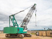 Green truck crane with box Stock Images