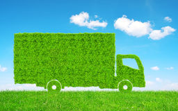 Green truck in grass. Concept of ecology transport Royalty Free Stock Images