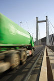 Green Truck In Motion on a cable-stayed bridge Royalty Free Stock Photo