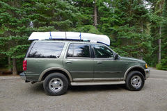 Green Truck with a White Canoe on the Top. This is taken in the camp site of Manning Park, BC, Canada royalty free stock photo