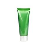 Green tube  with cream on white background Stock Photos