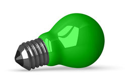 Green tungsten light bulb lying Royalty Free Stock Images