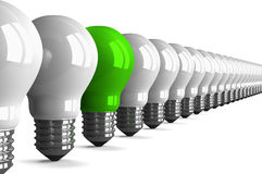 Green tungsten light bulb and many white ones, perspective view Royalty Free Stock Photography