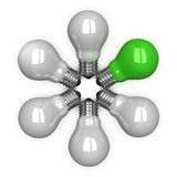 Green tungsten light bulb among white ones lying radially Royalty Free Stock Photography
