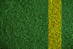 Green turf grass texture with yellow line, in soccer field. Green turf grass texture with yellow line , in soccer field stock photography