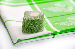 Green turkish delight on the green tablecloth Royalty Free Stock Photography