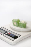 Green turkish delight on the kitchen digital scale Royalty Free Stock Images