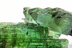 Green turmaline. Gross tourmaline crystal with all I tonsde green and natural texture Royalty Free Stock Image