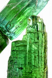Green turmaline. Gross tourmaline crystal with all I tonsde green and natural texture Stock Photo