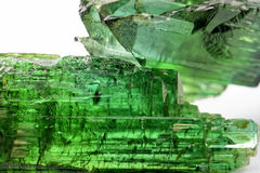 Green turmaline. Gross tourmaline crystal with all I tonsde green and natural texture Stock Image