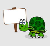 Green turtle with billboard Stock Photography