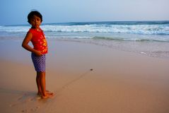 Green Turtle Hatchling and Sri Lankan Girl Royalty Free Stock Photography