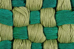 Green twisted skeins of floss as background texture Royalty Free Stock Images
