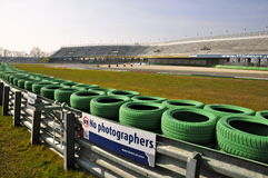 Green Tyre Wall of Assen Race Track. Green Tyres, Guard Rail and sign that says No Photographers for Safety Reasons stock photo