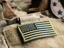 Green U.S. Flag On The Bulletproof Vest. Green US flag patch on the tactical bulletproof vest, selective focus royalty free stock photo