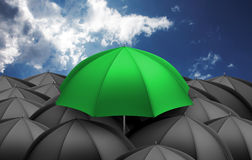 Green umbrella above the black ones Royalty Free Stock Photography