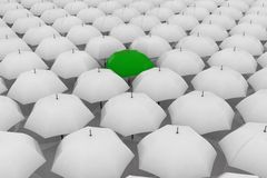 Green umbrella among other white umbrellas Royalty Free Stock Photography